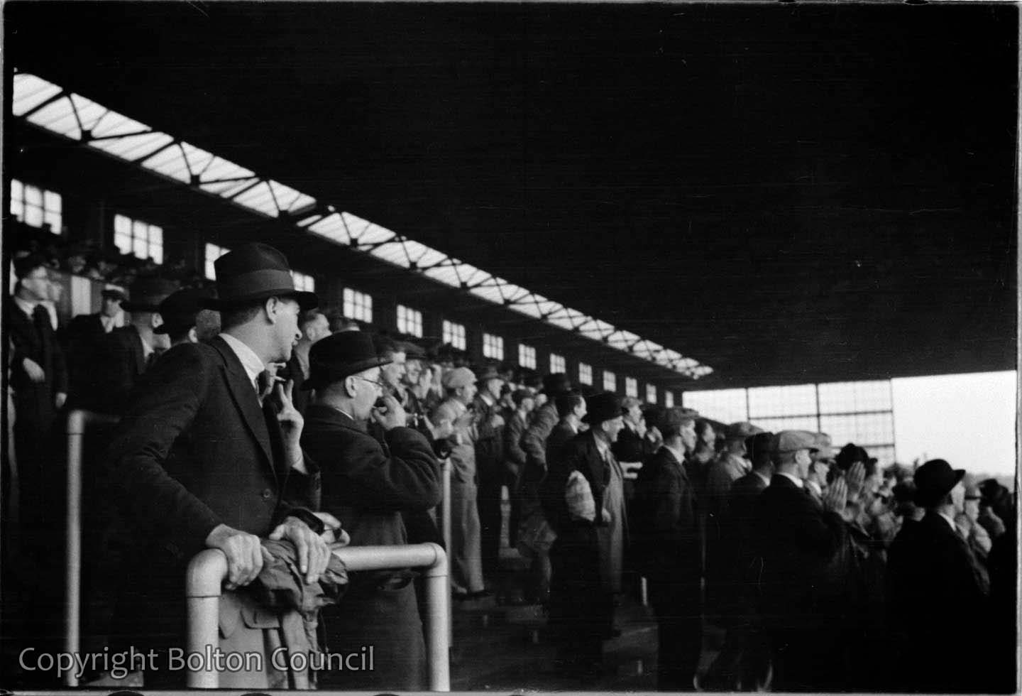 Spectators watch Bolton Wanderers reserve team play at Burnden Park