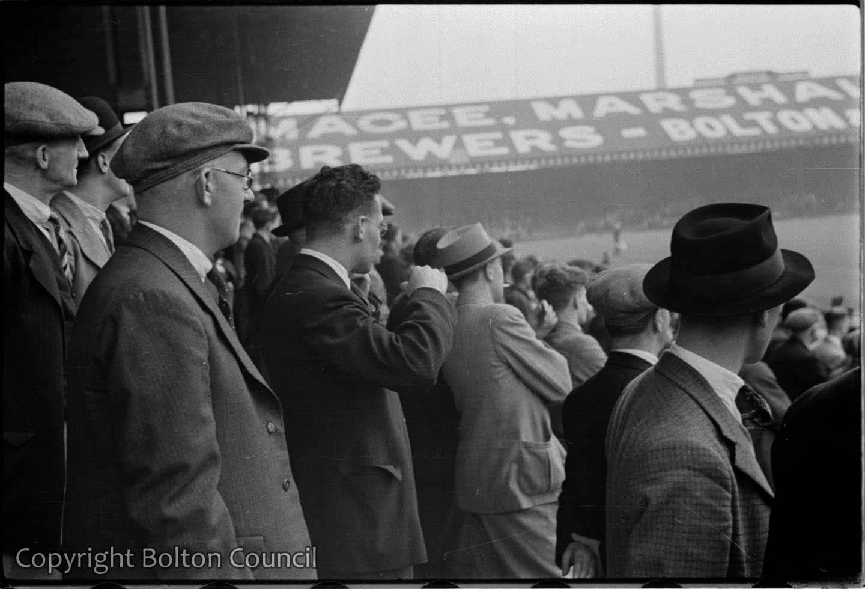 Spectators watch Bolton Wanderers reserve team play at Burnden Park