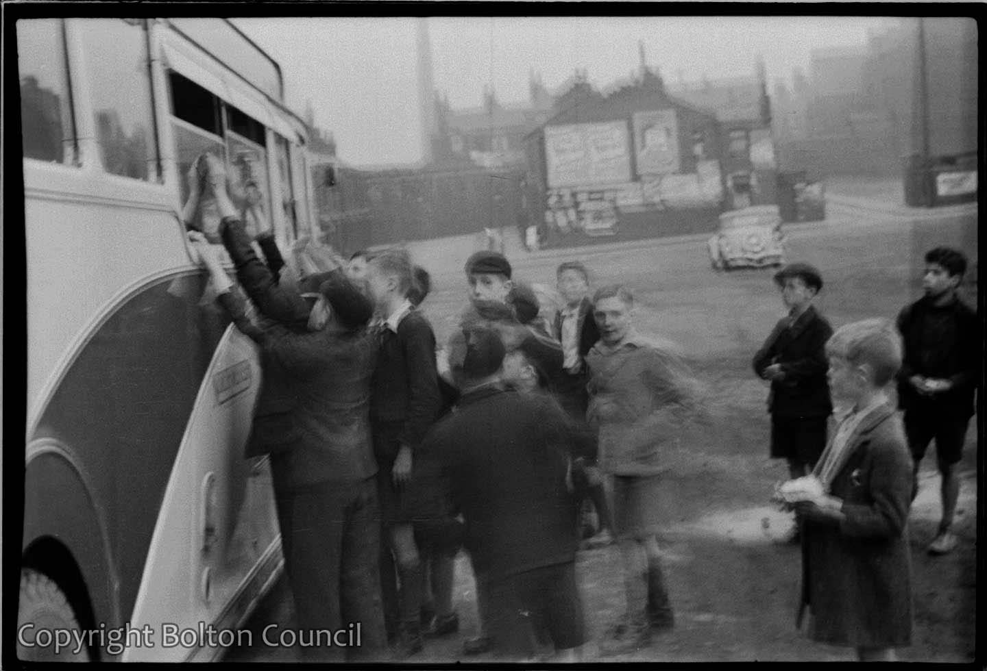 Boys wait for footballers autographs after a Bolton Wanderers reserve team game at Burnden Park