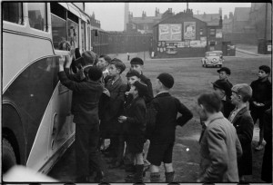 Boys ask for footballers' autographs after a Bolton Wanderers reserve team game at Burnden Park.