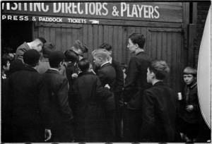 Boys ask for footballers' autographs after a Bolton Wanderers reserve team game at Burnden Park