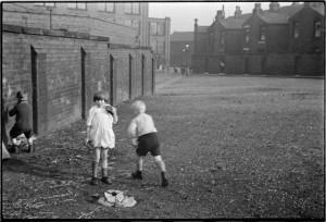 Children play on open land by Snowden St.