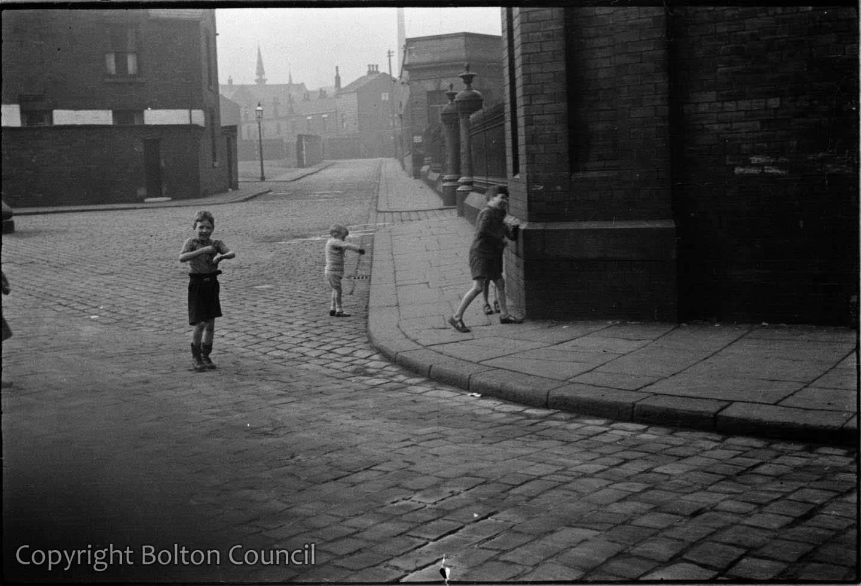Children play street games on Davenport Street