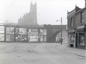 View of Bury New Road facing the viaduct. Parish Church in the background